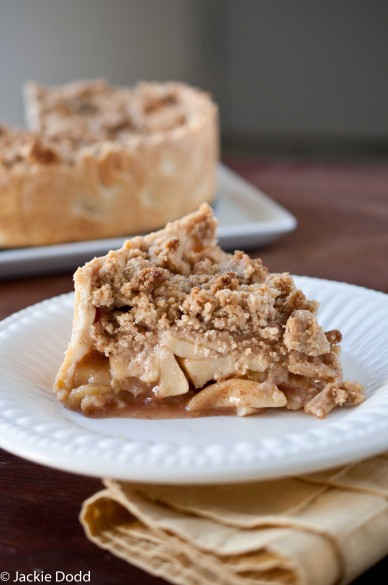 ' ' from the web at 'http://domesticfits.com/wp-content/uploads/2012/11/Deep-Dish-Apple-Streusel-Pie3-388x585.jpg'